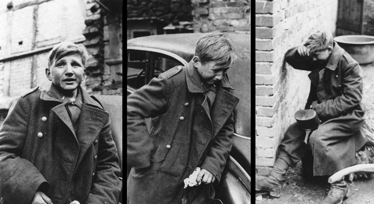 Hans-Georg Henke, soltado alemão de 16 anos, capturado pelos americanos depois de uma longa batalha. Ele começou a chorar num misto de choque e medo