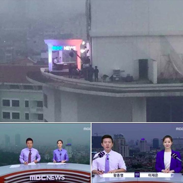 Programa de notícias coreano filmado no topo de um prédio, em vez de usar fundo verde com projeção de imagem.