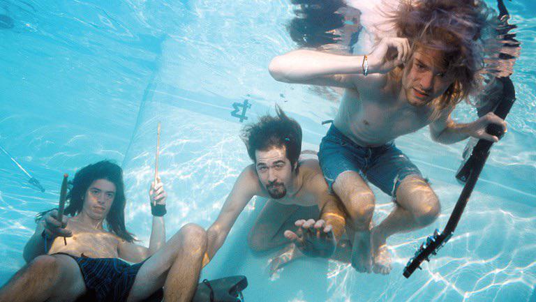 Nirvana durante sessão de fotos de seu álbum Nevermind, 1991.